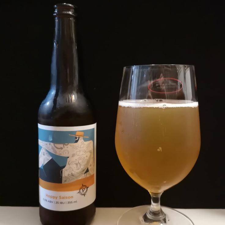 hoppy saison with glass